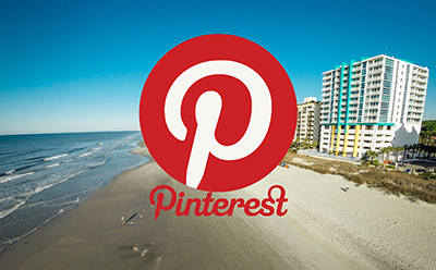 exterior view of seaside resort with pinterest logo