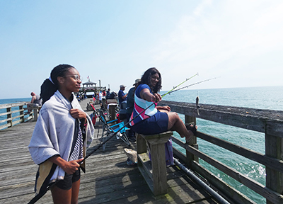Two people fishing on the cherry grove pier